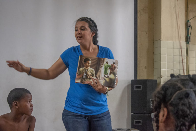 Women presenting book in Panama
